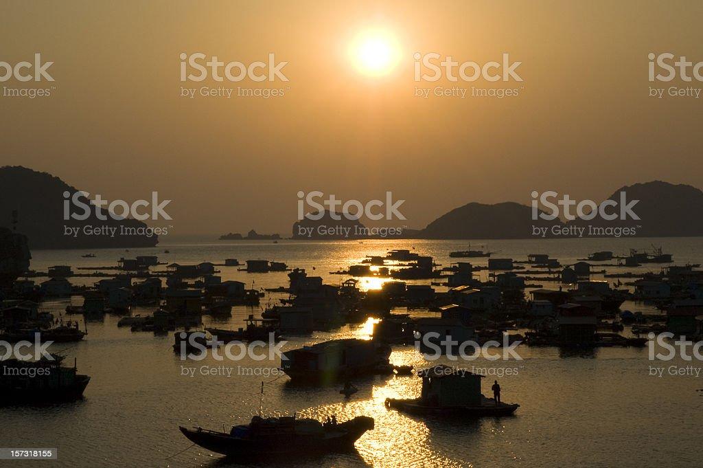 Sunset Over Houseboats Near Cat Ba Island, Halong Bay, Vietnam stock photo