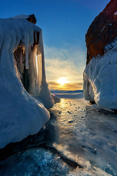 Sunset over ice covered Baikal stock photo