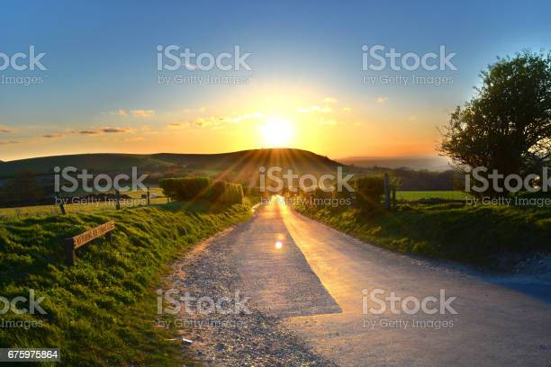 High dynamic range image of the setting sun as seen from the Jack and Jill windmills car park in Sussex, England.