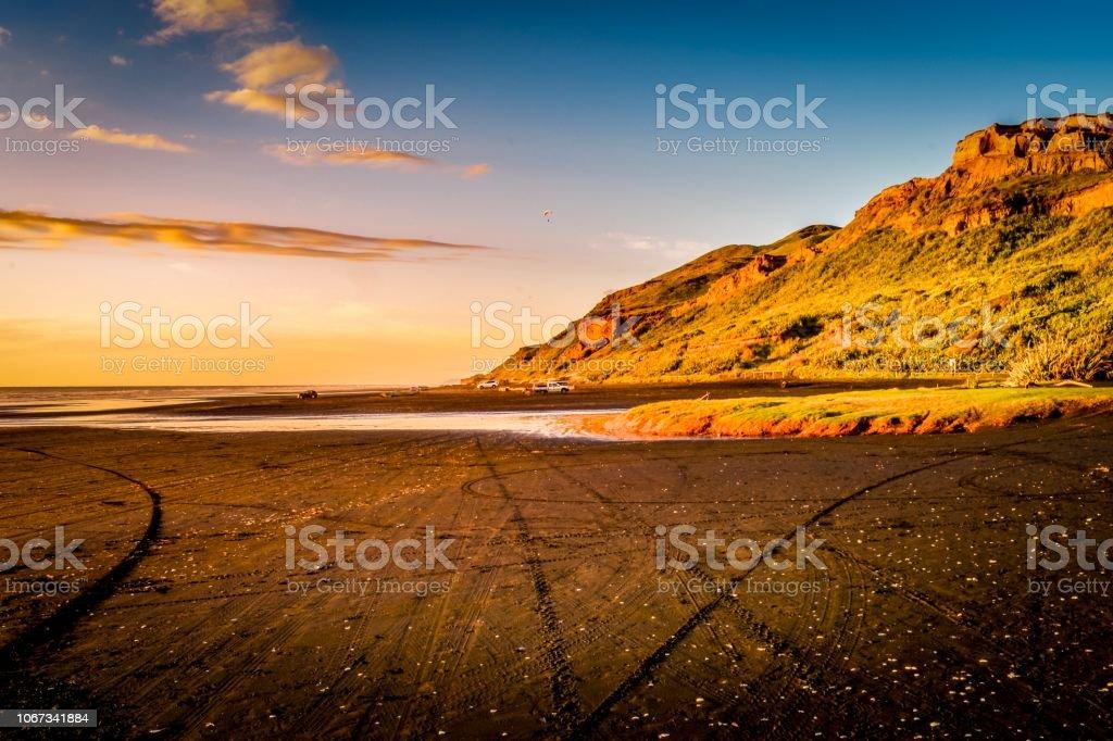 Sunset over Karioitahi beach black sand Waiuku stock photo