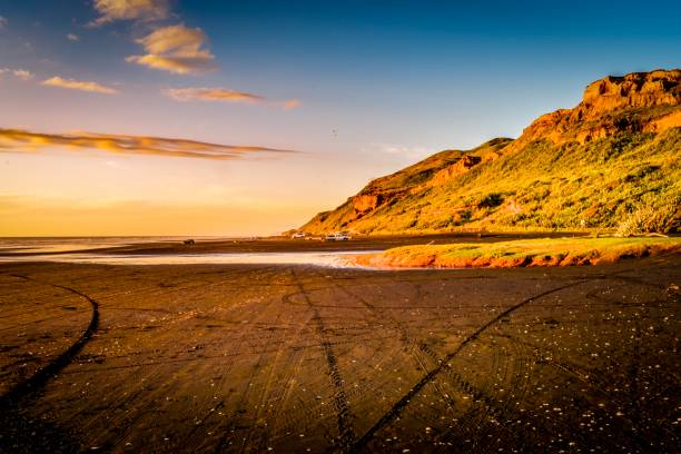 Sunset over Karioitahi beach black sand Waiuku stock photo