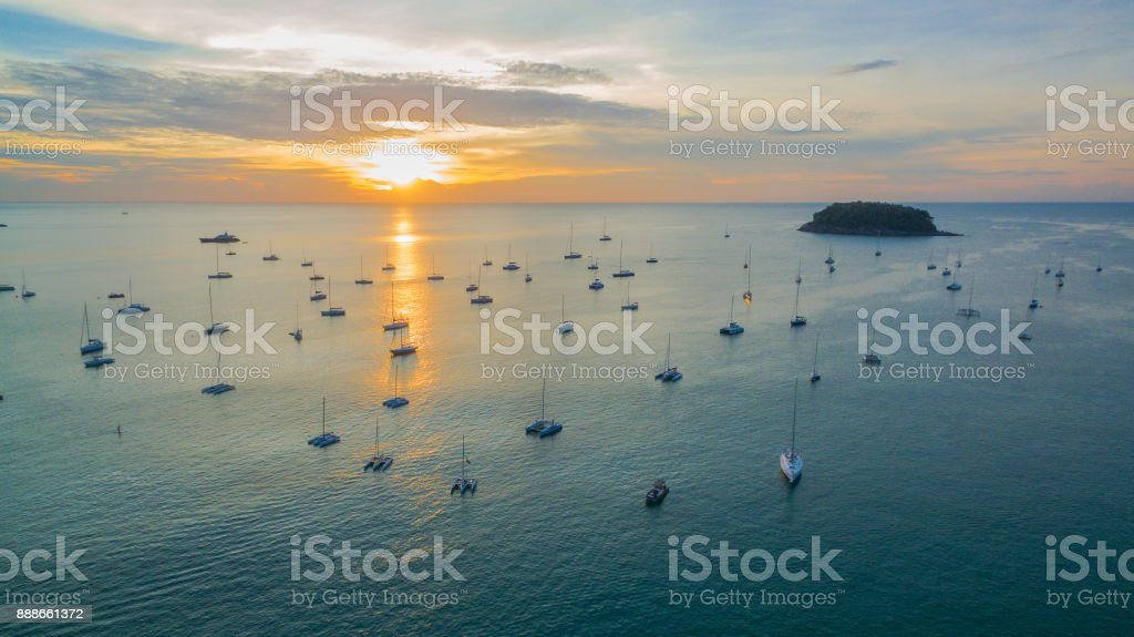 Sunset over Kata Bay. Yachts parked in the  Kata bay stock photo