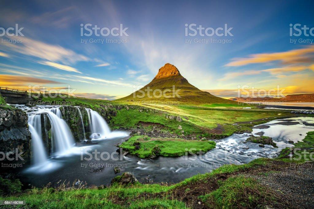 Sunset over Kirkjufellsfoss Waterfall and Kirkjufell mountain in Iceland stock photo