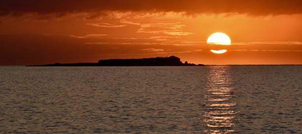 Sunset over Lagoudia Island, Corfu, Greece stock photo