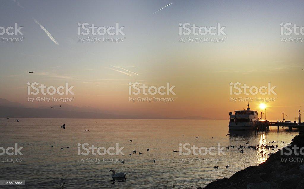 Sunset Over Lake Geneva With a Passenger Ferry stock photo