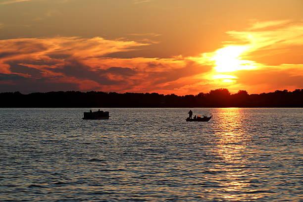 Sunset over Lake Washington with Pontoon and Fishing Boat - Photo