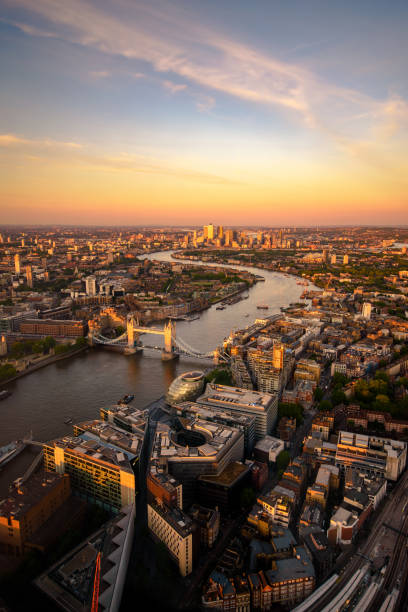 Sunset over London An aerial view over the city, looking towards Tower Bridge and Canary Wharf antenna aerial stock pictures, royalty-free photos & images