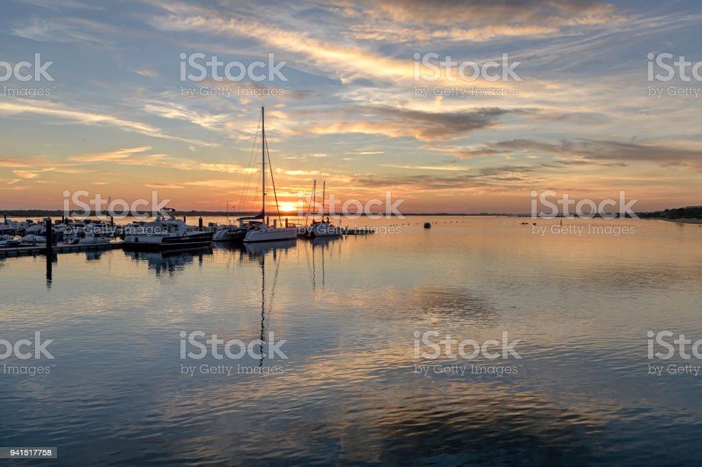 Sunset over marina in Nuevo Portil, Spain. stock photo