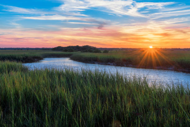 Sunset over Matanzas River in St. Augustine Sunset over marshy branch of the Matanzas River in St. Augustine, Florida southern usa stock pictures, royalty-free photos & images