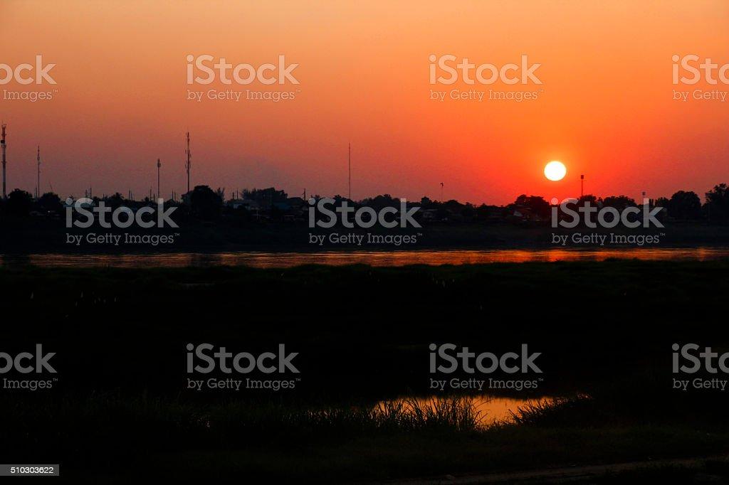 Sunset over Mekong stock photo