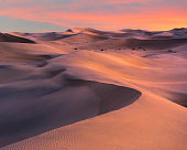Colorful sunset over sand dunes in Death Valley National Park