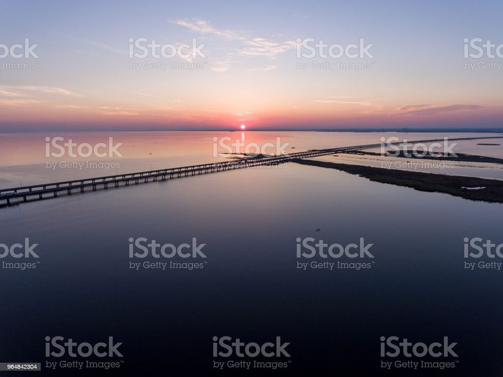 Sunset over Mobile Bay and interstate 10 bridge royalty-free stock photo