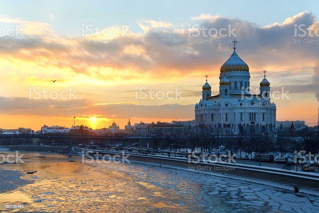 Sunset over Moscow river and church of Christ the Savior stock photo