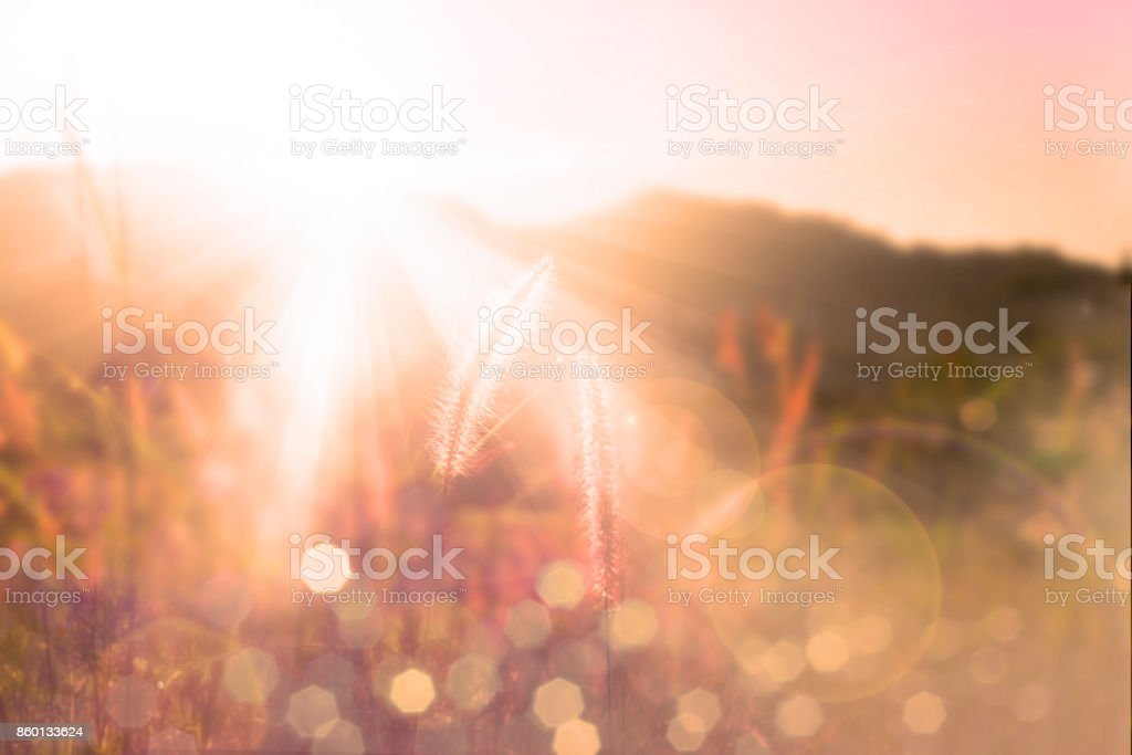 Sunset over mountain bokeh stock photo