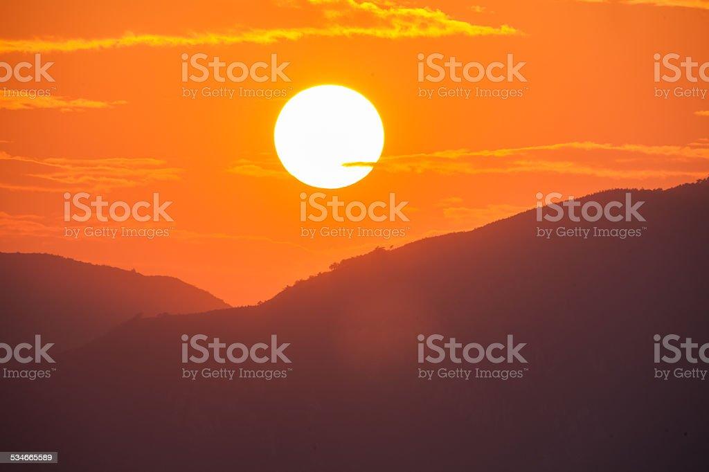 sunset over mountain stock photo