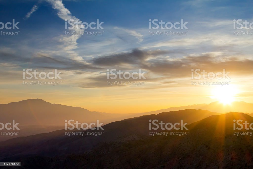Sunset Over Mountain Range stock photo