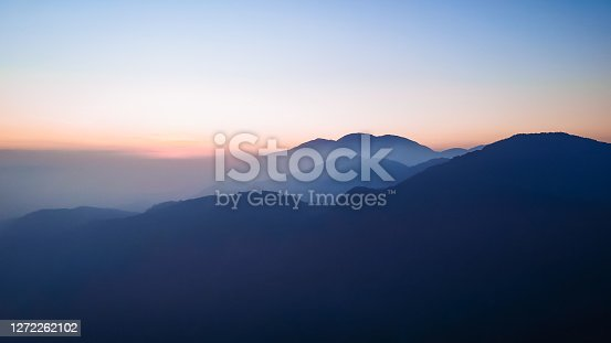 istock sunset over mountains 1272262102