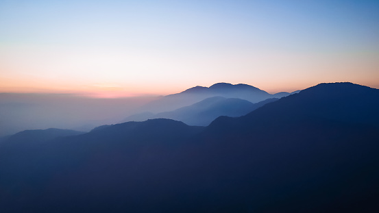 Sunset over cloudy mountains