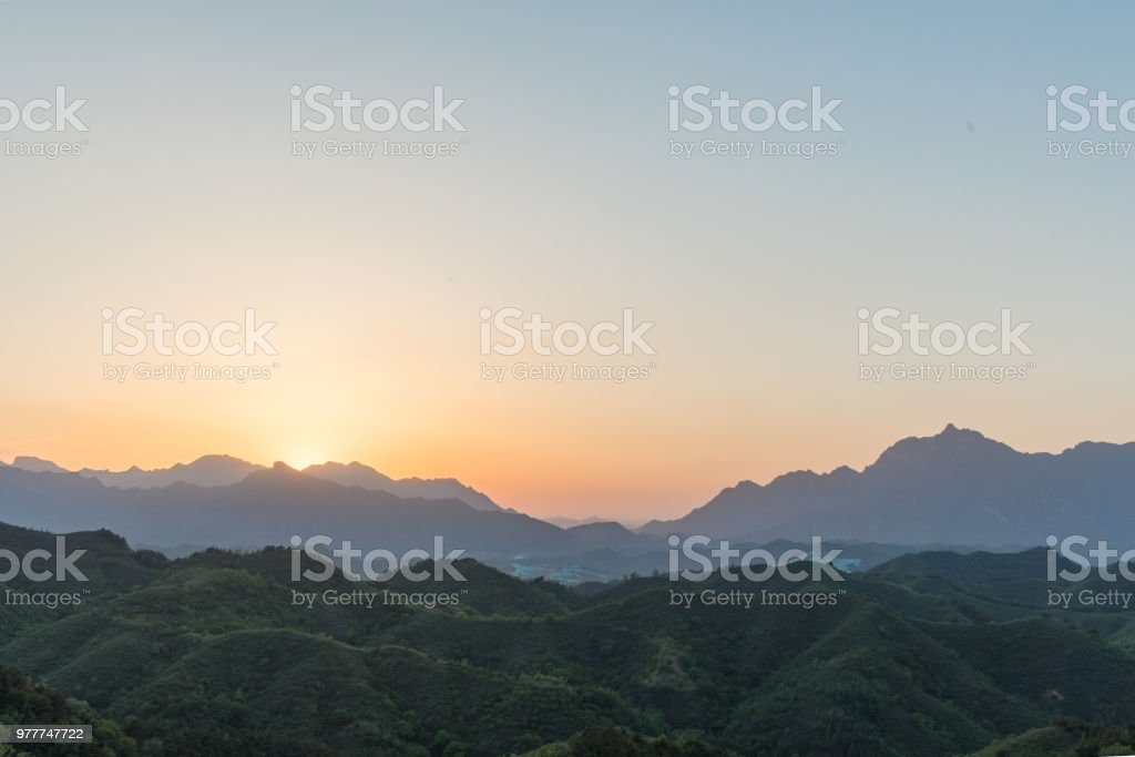 Sunset over mountains stock photo