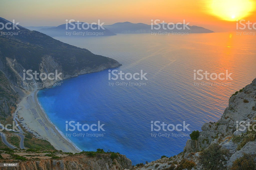 Sunset over Myrtos beach in Polaris, Greece stock photo
