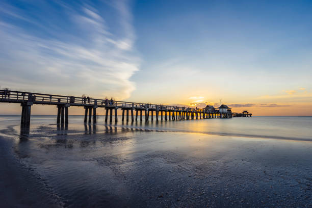 Sunset over Naples Pier in Florida from the beach stock photo