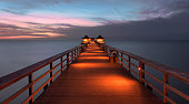 Naples, Florida, USA - December 13, 2018: Panorama sunset over the Gulf of Mexico and the historic Naples Pier