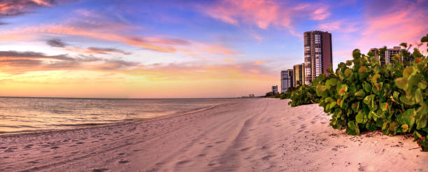 Sunset over North Gulf Shore Beach along the coastline of Naples Sunset over North Gulf Shore Beach along the coastline of Naples, Florida naples florida stock pictures, royalty-free photos & images