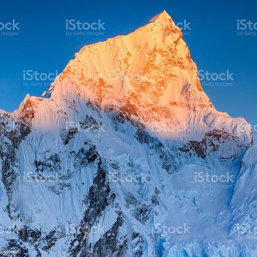Sunset over Nuptse peak in Mount Everest National Park royalty-free stock photo