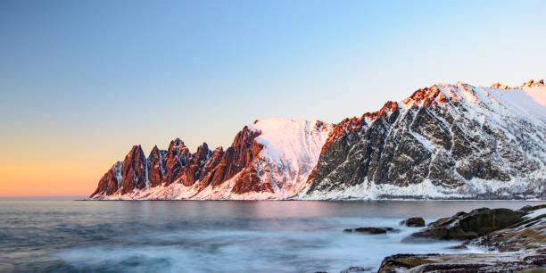 sunset over okshornan mountain range in northern norway in winter - headland stock pictures, royalty-free photos & images