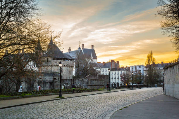 Sunset over old town in Nantes, France stock photo
