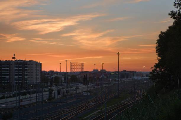 sunset over ostiense station - roma foto e immagini stock