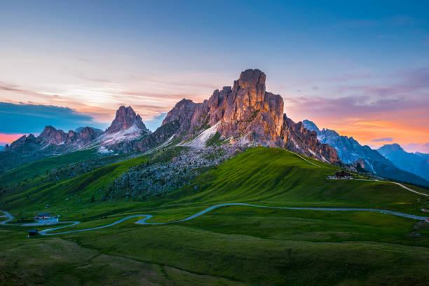 sunset over pass giau. dolomites alps. italy - dolomiti foto e immagini stock