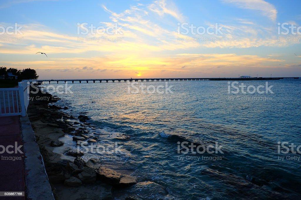 Sunset over pier stock photo