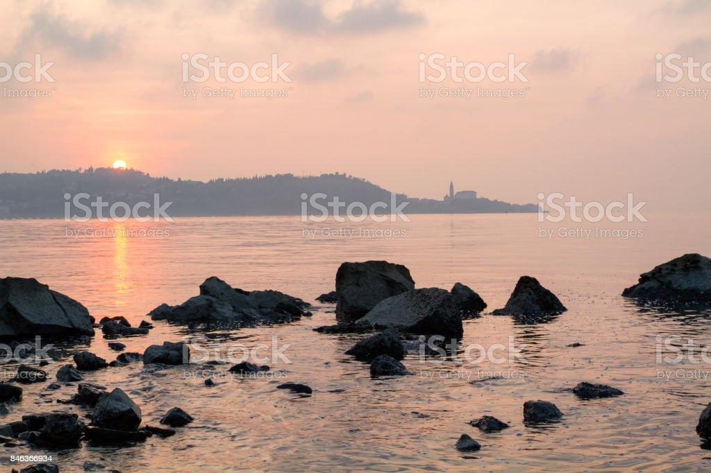 Sunset over Piran town from Strunjan nature reserve. stock photo