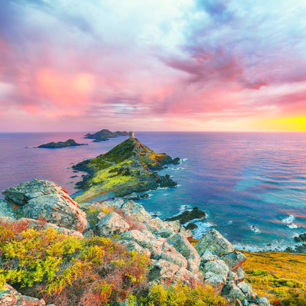 Sunset over popular tourist destination Torra di a Parata with Genoese Tower and Archipelago of Sanguinaires islands at background stock photo