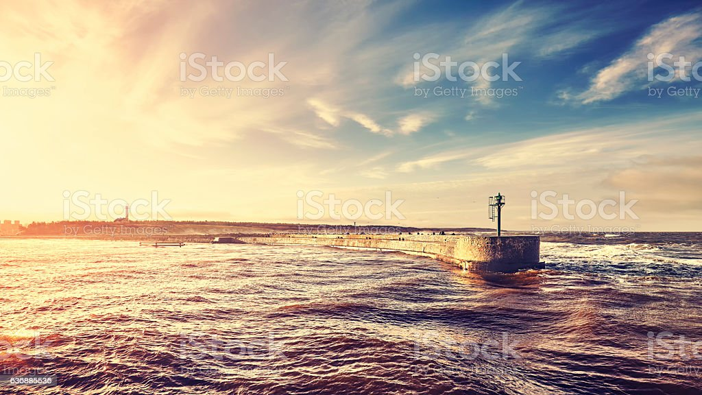 Sunset over port entrance in a storm. stock photo