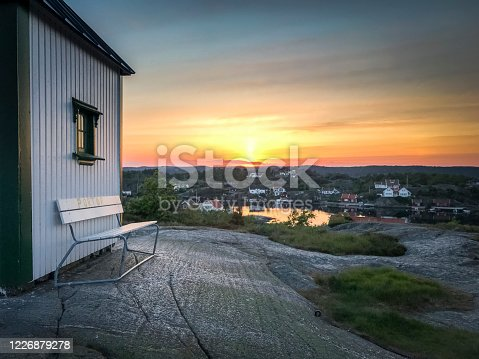 Peaceful sunset near with lighthouse Norway