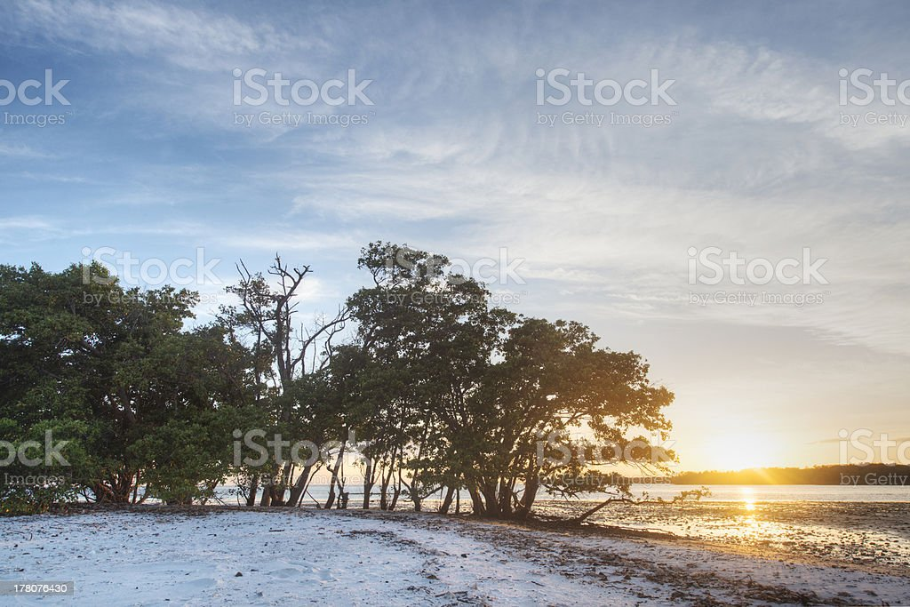 Sunset over private island stock photo