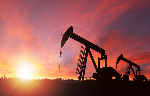 Sunset Over Pumpjack Silhouette With Copy Space Stock Photo - Download Image Now