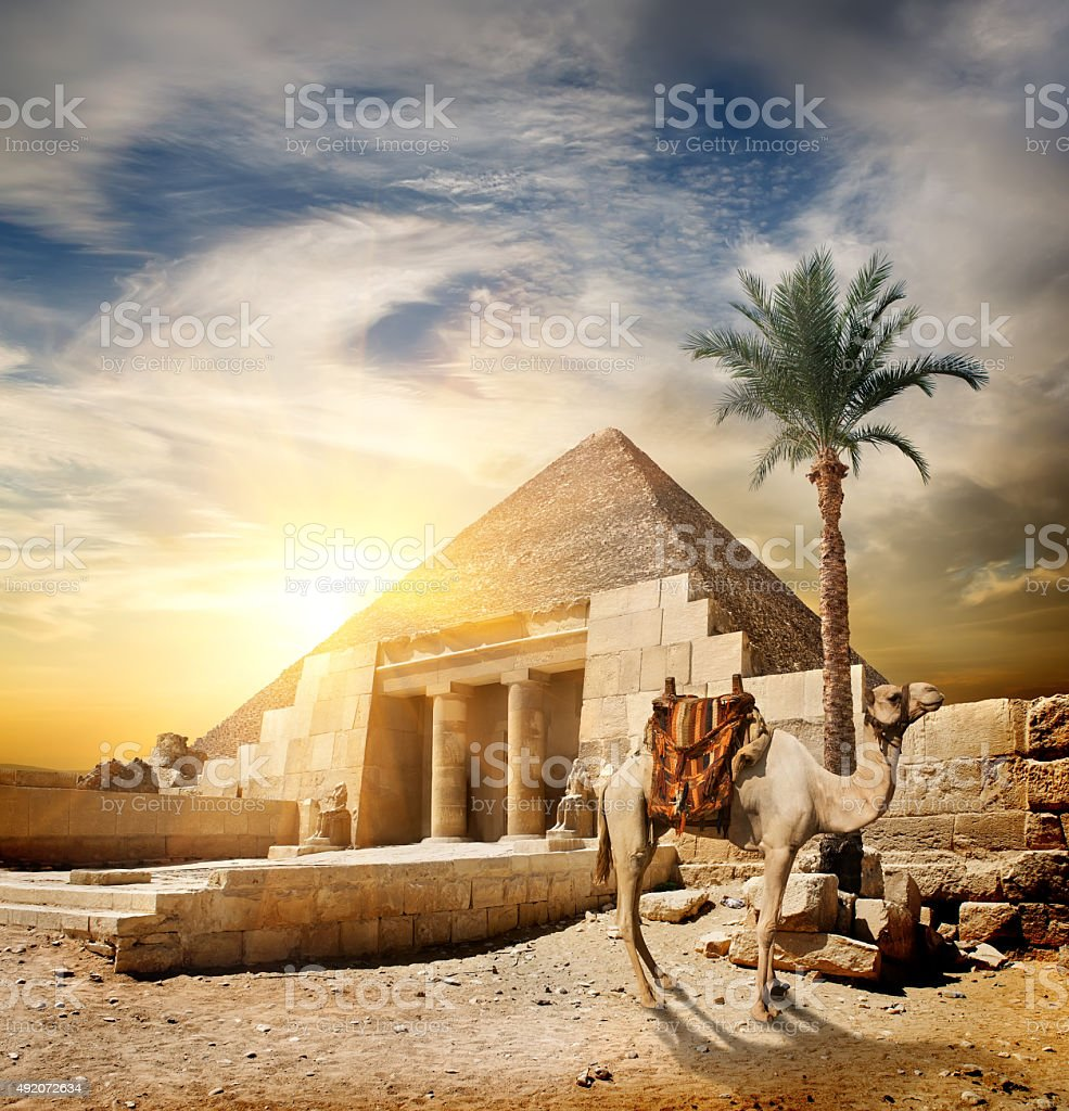 Sunset over pyramid stock photo