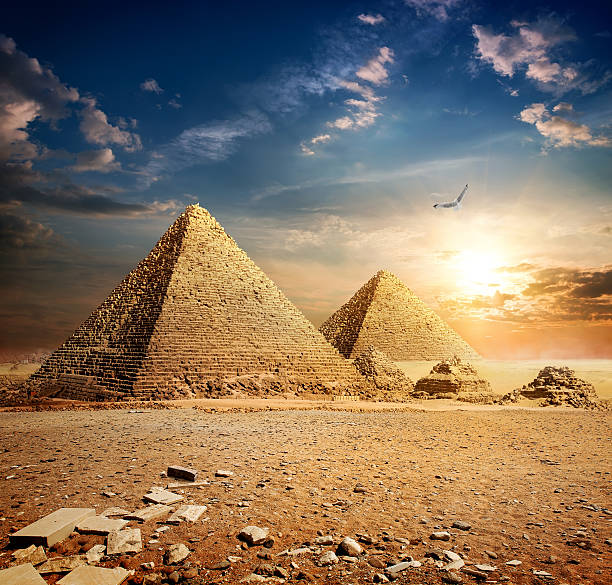 Sunset over pyramids stock photo