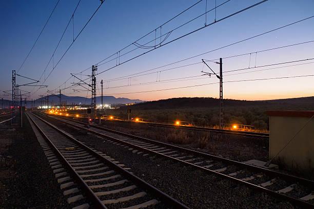 Sunset over railway infrastructures stock photo