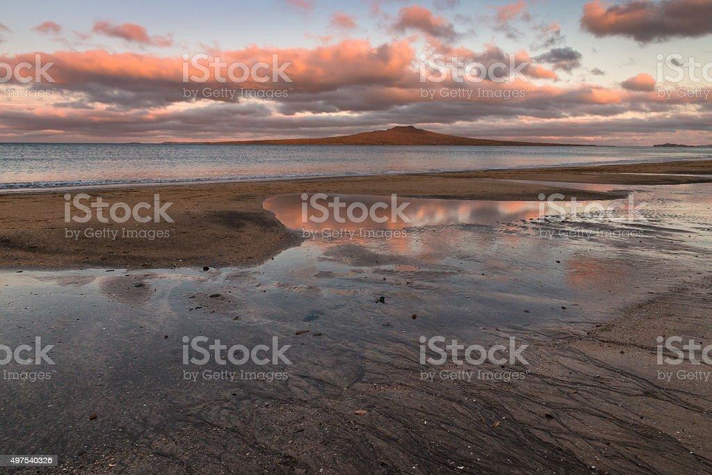 sunset over Rangitoto Island stock photo