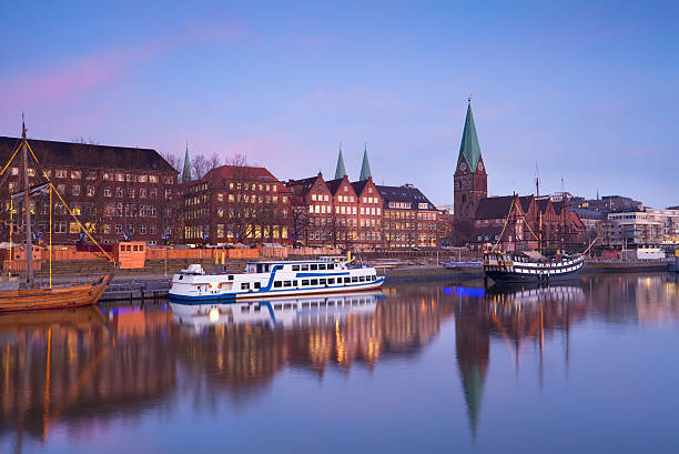 sunset over river in Bremen city stock photo