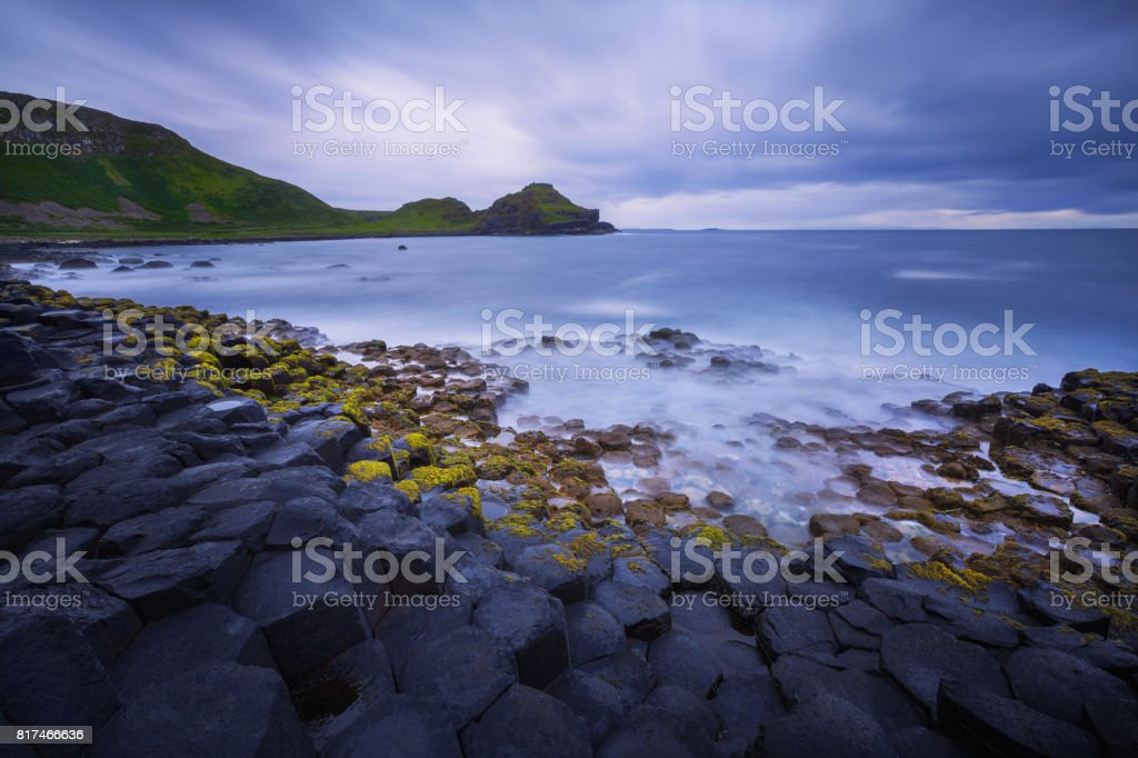 sunset over rocks formation Giant's Causeway, County Antrim, Northern Ireland, UK stock photo