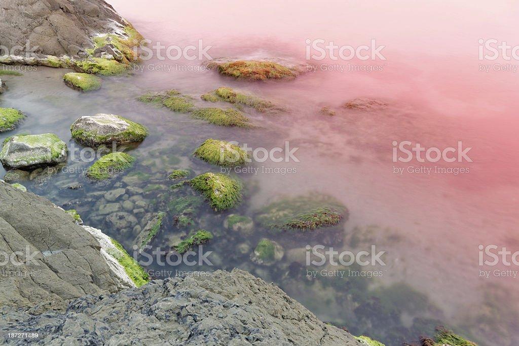 Sunset over rocky beach royalty-free stock photo