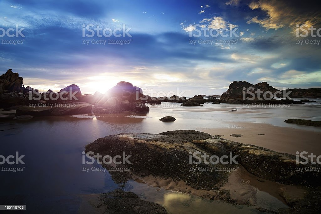 Sunset over rocky coast royalty-free stock photo