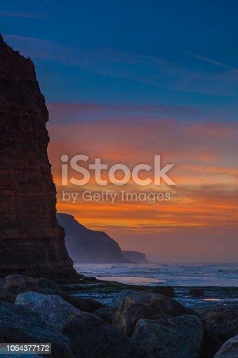 Sunset on a North Sea rocky coastline.