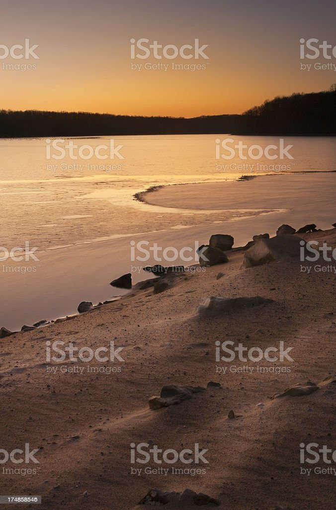 Sunset Over Rocky Lake Shore royalty-free stock photo