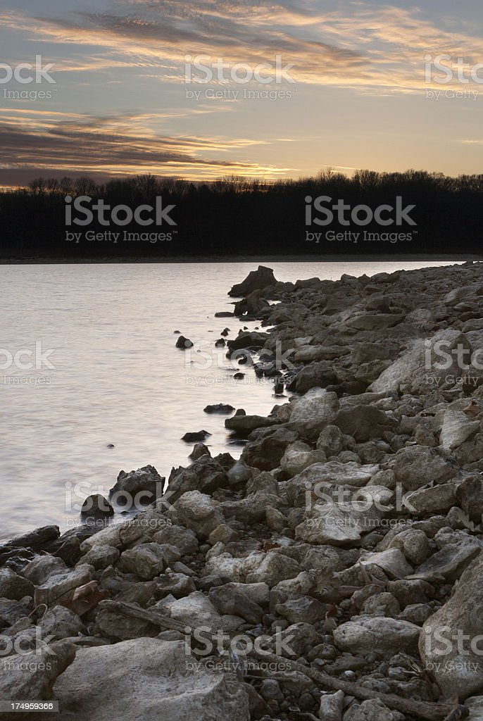 Sunset Over Rocky Lake Shore royalty-free stock photo